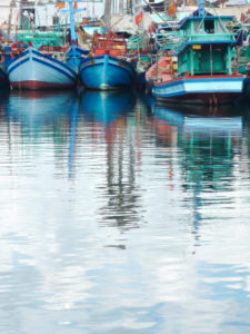 Fishing boats, reflection in the water, harbour, Ph∑ Quoc, Vietnam