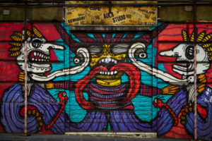 Graffiti, house wall, street art, Head-on, region Liguria, Genoa, Italy