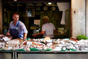 Market scene, fish stall, seller, fish, Venice Italy