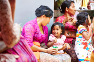 Mother playing with daughter, little girl laughing, reportage, traditional wedding, Bali, Indonesia, Asia