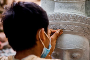 Mason carving statue, man at work, stone relief, piece of art, Angkor Wat, Cambodia,