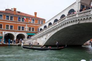 Gondola on the Grand Canal under the Rialto Bridge in Venice