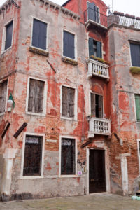 Residential house with closed shutters in Venice