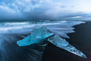 Iceland, glacial ice on the lava beach in the Jökulsarlon glacier lagoon before sunrise