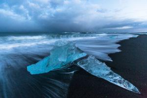 Iceland, glacial ice on the lava beach in the Jökulsarlon glacier lagoon before sunrise