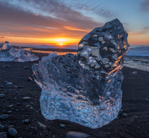 Iceland, glacier ice at the lava beach in the glacier lagoon Jökulsarlon, sunrise