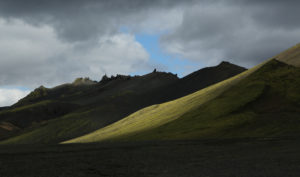 Iceland, landscape at the Alftavatn, evening light, black clouds and sunshine