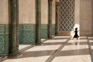 Girl runs in the vestibule of the Hassan-II. Mosque, Casablanca, Morocco