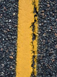 Algoma Region, Kanada, close up of the asphalt road, cracked roadway, province of Ontario, Trans-Kanada Highway