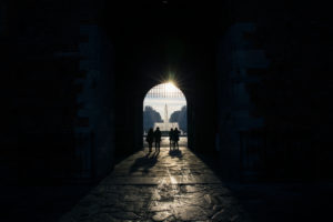 People in a dark passageway, Milan Street Photography, Italy