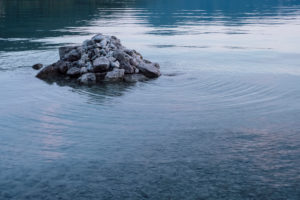 Stones in the water at Tegernsee, Germany