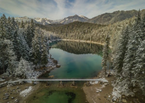 Aerial view over the bridge at the Eibsee into the Untersee, view towards the Ammer Mountains, snow-covered trees, turquoise water, beginning of winter, Eibsee, Grainau, Garmisch-Partenkirchen, Upper Bavaria, Bavaria, southern Germany, Germany