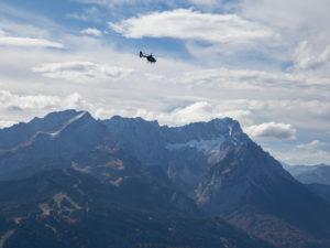 Helicopter over Wetterstein Mountains with Alpspitze, Jubiläumsgrat, Zugspitze, Höllental and Waxensteinen, blue sky, clouds, Garmisch-Partenkirchen, Upper Bavaria, Bavaria, Southern Germany, Germany