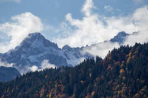 Mountain peak Oberreintalschrofen in the Wetterstein Mountains, clouds, blue sky, trees, autumn, Garmisch-Partenkirchen, Upper Bavaria, Bavaria, southern Germany, Germany