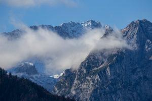 Clouds of mist envelop Waxensteine and Höllental as well as Zugspitze, Wetterstein Mountains, blue sky, fog, clouds, Garmisch-Partenkirchen, Upper Bavaria, Bavaria, southern Germany, Germany
