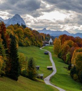 Kirchdorf Wamberg with St. Anna's Church above Garmisch-Partenkirchen in autumn, Bauernstadel, promenade, trees, clouds, Garmisch-Partenkirchen, Upper Bavaria, Bavaria, southern Germany, Germany
