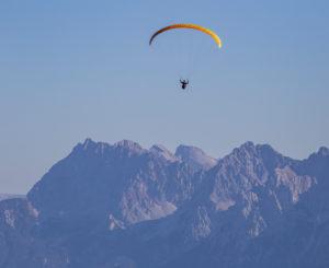 Paraglider against Karwendel Mountains, blue sky, Garmisch-Partenkirchen, Upper Bavaria, Bavaria, southern Germany, Germany