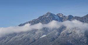 Kramer with clouds of fog in winter, blue sky, snow, trees, Garmisch-Partenkirchen, Upper Bavaria, Bavaria, southern Germany, Germany