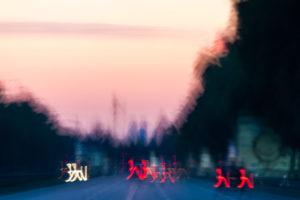 Conception - Lights cross a big street in the sundown,
