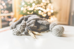 Cozy Christmas with beautiful lighting and knitting with big needles and beautiful wool.