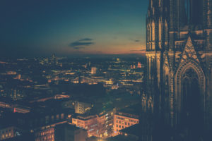 The Cologne Cathedral, close-up of the towers and view over Cologne at the Blue Hour