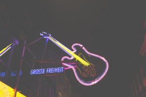 At night on the Reeperbahn - around St.Pauli the bars attract with their colorful neon sign. The big freedom 36 lures.