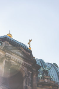 The golden cross on the Berlin Cathedral at the Liebknecht bridge.