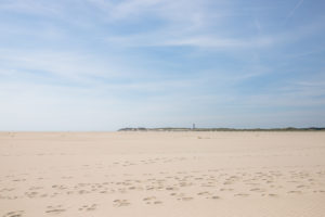 A lighthouse in the north of Amrum. Amrum, an island in the German North Sea - sand as far as the eye can see. Wittdün