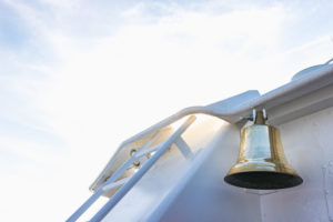 A ship's bell on a ship in the backlight - it's time!