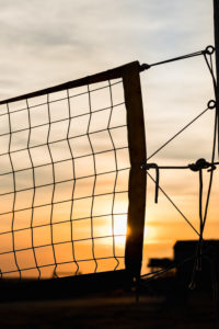 Beach volleyball - a backlit net at sunset