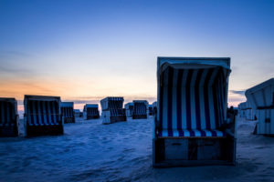 Relaxation in a beach chair. The North Sea at sunset. Wadden Sea and Beach, Blue Hour