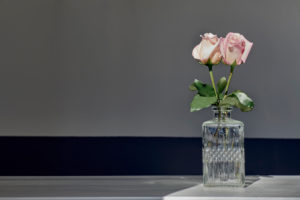Two roses in crystal glass vase