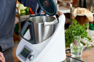 Photo series, step-by-step preparation of a leg of lamb stuffed with herbs and Provençal vegetables by using a food processor (Thermomix ® and Varoma ®), preparing the herb filling