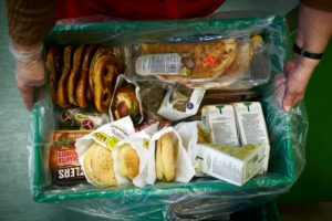 Box of donated expired supermarket products from the Augsburger Tafel.