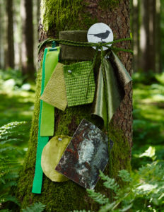 Green fabrics and decoration in the forest
