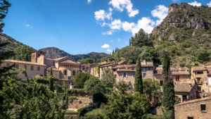 "Gellone monastery in Saint Guilhem le Désert in spring. The monastery grounds were built in the 9th century and have been recognized as part of the UNESCO World Heritage Site ""Jakobsweg in Frankreich"". The village belongs to the Plus Beaux Villages de France."