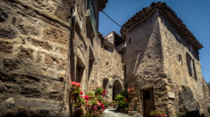 Village alley in Saint Guilhem le Désert in spring. The village belongs to the Plus Beaux Villages de France. Located on the pilgrimage route to Santiago de Compostela.
