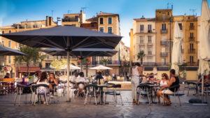 Cafe on Place de l'Hôtel de Ville in summer