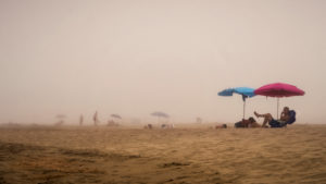 Bathers in fog at Narbonne Plage in summer