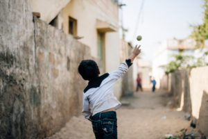 A boy while playing with the ball in a village in the Rann of Kutch in Gujarat, India