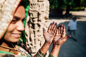 A woman shows us her henna painting at the solar temple in Modhera, India