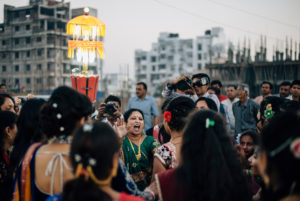 Women while dancing on the street during an Indian wedding, Vadodara