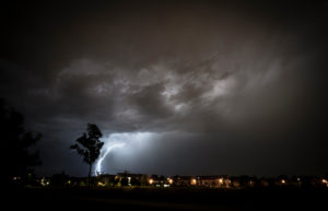 Long-exposure photography thunderstorm at night, dark cloud, tree