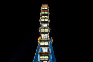 Long time exposure at night at the Oktoberfest, fairground rides
