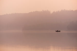 Angler in the fog, lake, boat,