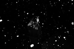 Woman with snowflakes at night