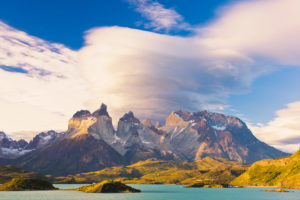 Chile, Magallanes Region, Torres del Paine National Park, Lago Pehoe, Lenticular Clouds above the Cuernos del Paine Mountains