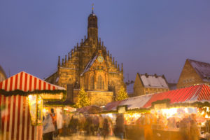 Germany, Bavaria, Nuremberg, Christmas Market with the Frauenkirche in the background