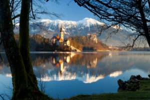 Slovenia, Upper Carniola, Bled, Assumption of Mary Church reflected in Lake Bled