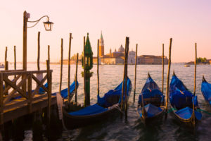 Gondolas with the church of Saint George Major in  the distance, Venice, Italy